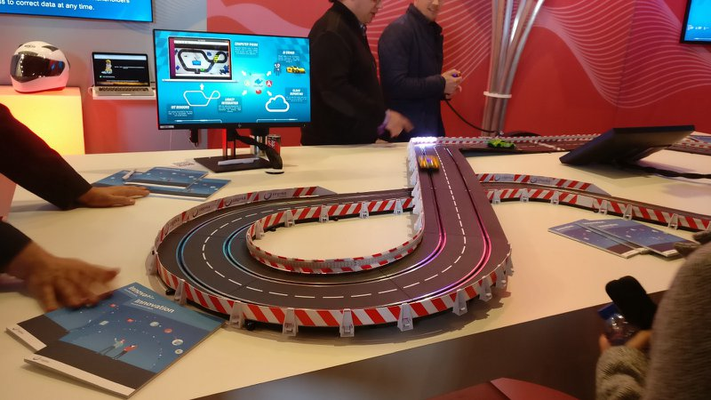 """Hot Wheels racing versus a robot hand that uses IoT sensors and computer vision to stay on track. I call it cheating, they call it """"innovation""""."""