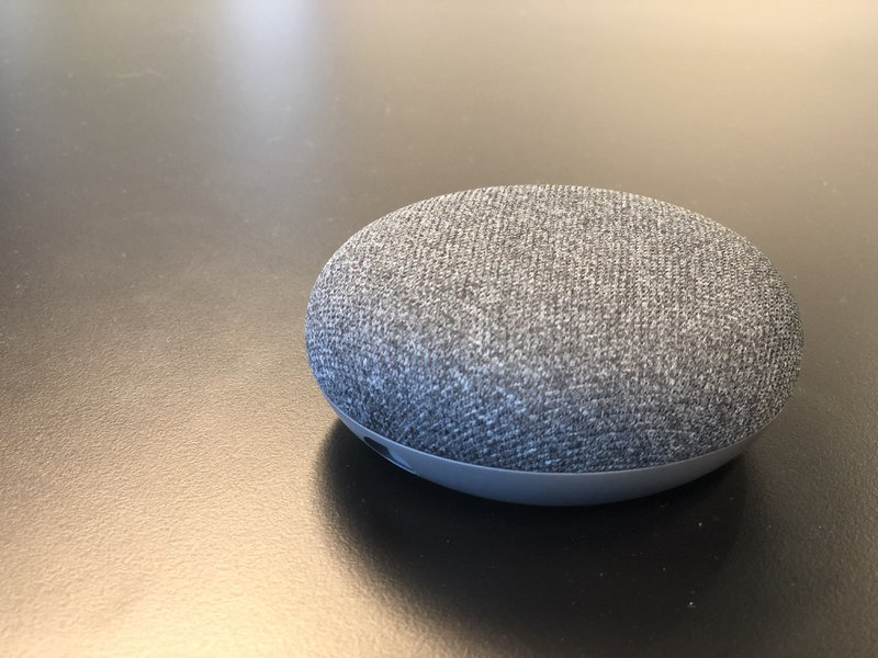 Google Home Mini featuring Google Assistant