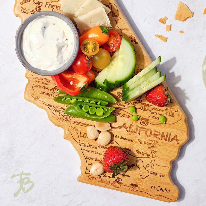 A bamboo cutting board with fresh produce