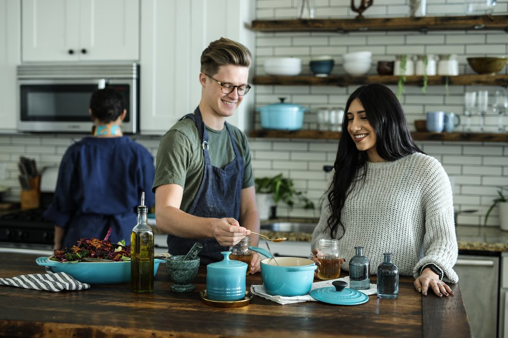 Two people preparing dinner with eco-friendly cookware