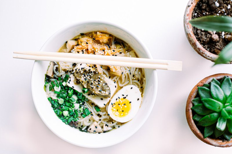 A bowl of ramen topped with winter vegetables.