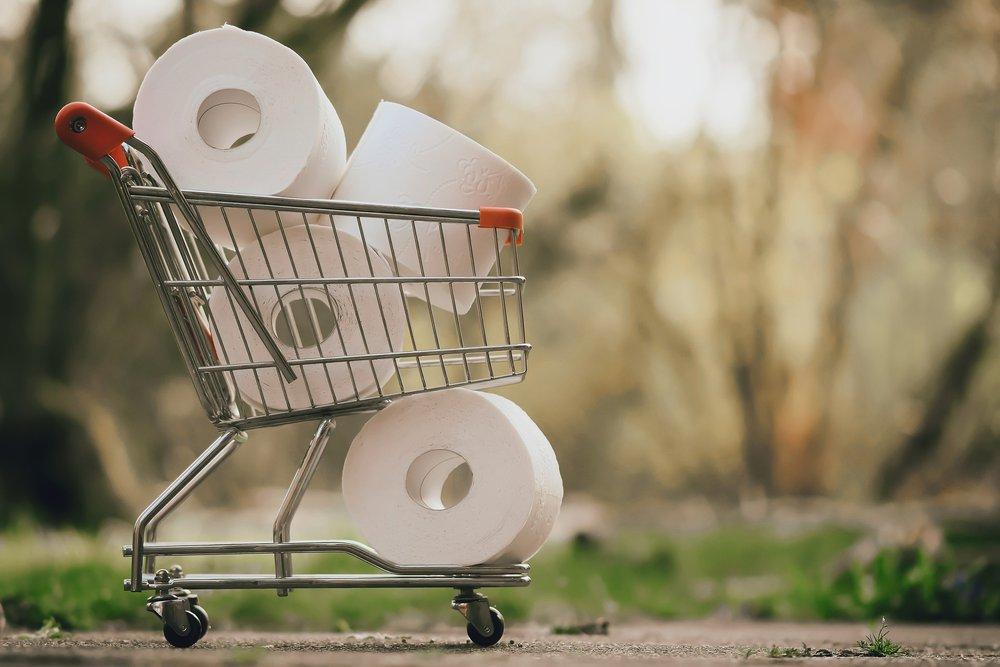 A cart full of toilet paper rolls