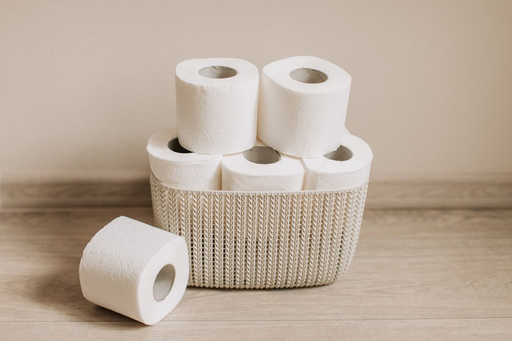 A basket of toilet paper rolls