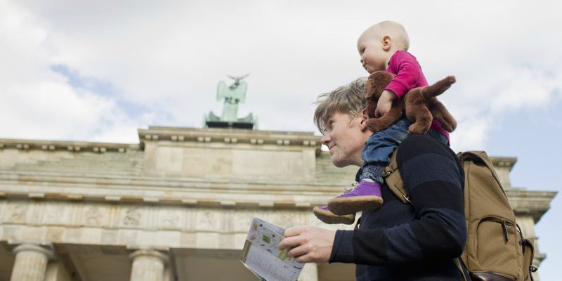 a man and his baby are visiting US historic monuments