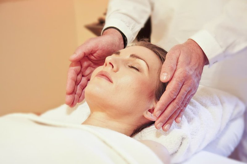 woman receiving a Reiki session
