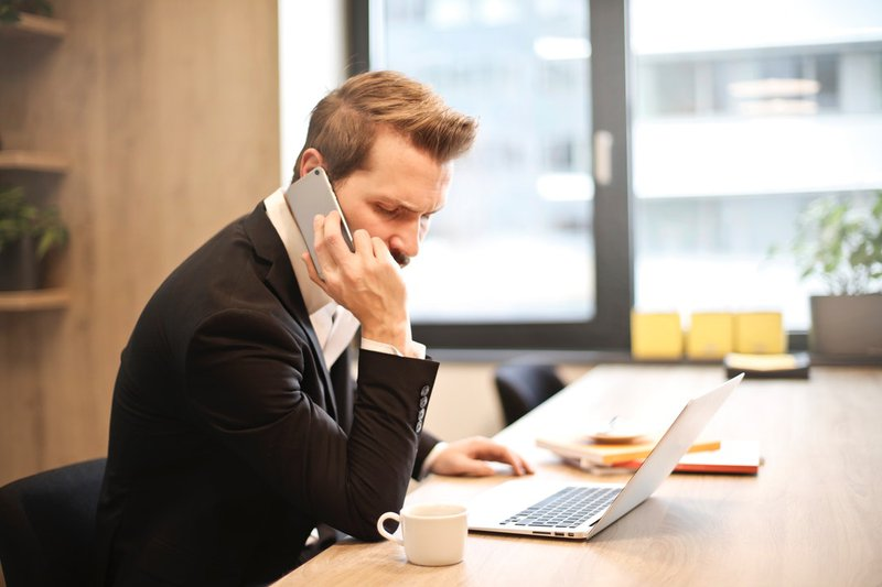 man on the phone after studying sales tips for cold calling