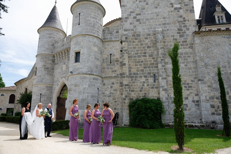 wedding venues in france - wedding party outside chateau de lisse