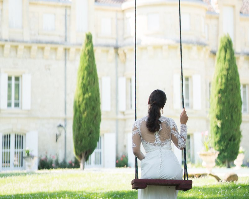 bride on a swing outside chateau plombis