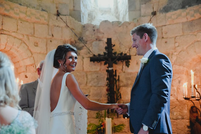 bride and groom in french chapel