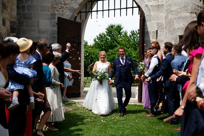 wedding venues in france - couple getting married at a french chateau