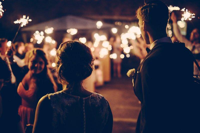 bride and groom - subtle outside lighting and sparklers