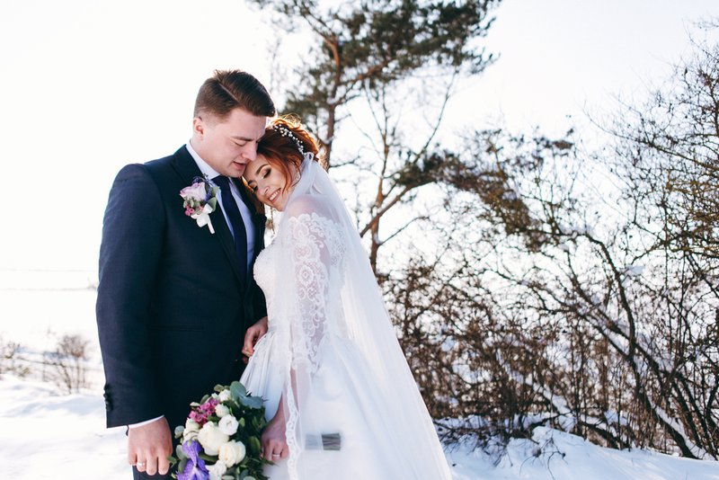 planning a wedding in france - winter bride and groom