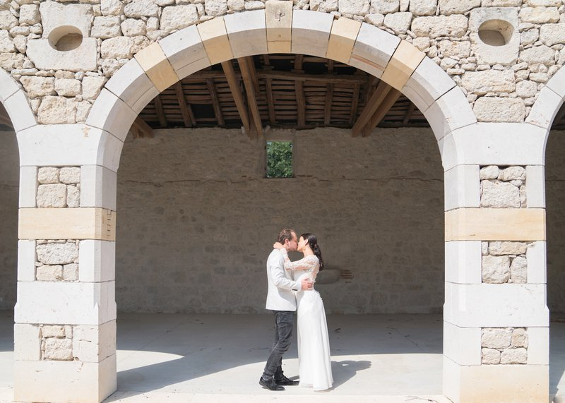 wedding in france couple under arch