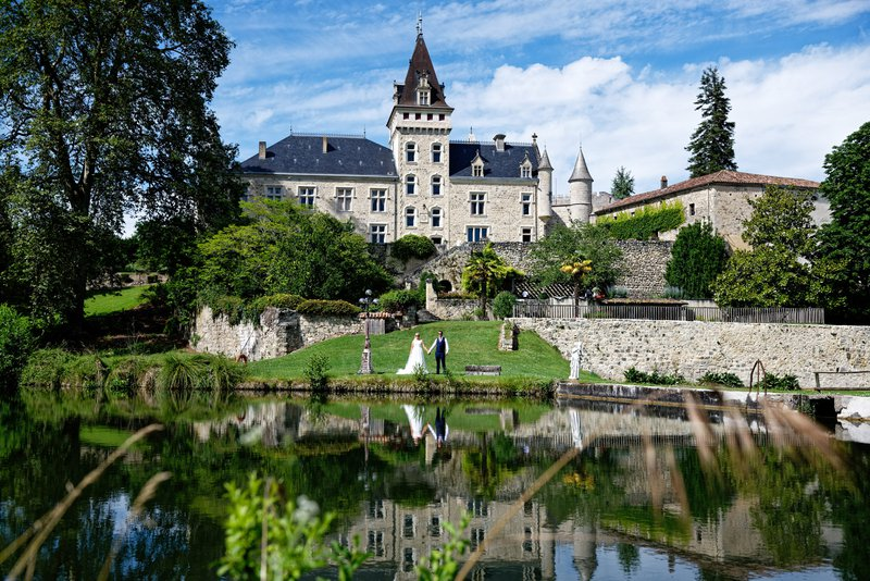 wedding venues in france - bride and groom outside chateau de lisse