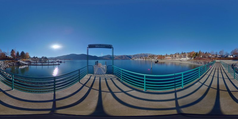 Lake Chelan, the third-deepest lake in the USA.  Viewed from Manson Bay pier, (facing south-southwest) with the east slope of the Cascade Mountains (Bear Mountain and Stormy Mountains visible across the 55-mile long lake), and Wapato Point isthmus to the left. Feel free to TEST and use this equirectangular image.  It may be posted to Facebook (and perhaps some other social media, etcetera), where its EXIF Data, when interpreted properly, may form a working 360-degree panorama (which can then be manipulated or pushed around as well as up and down by the viewer).  ~Timothy Oldfield (2019-May)
