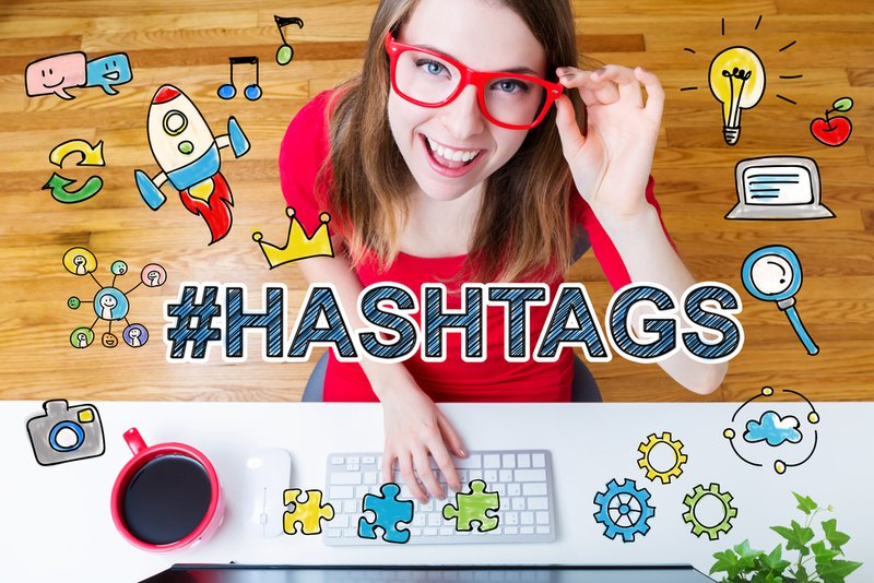 Hashtags concept with young woman wearing red glasses in her home office