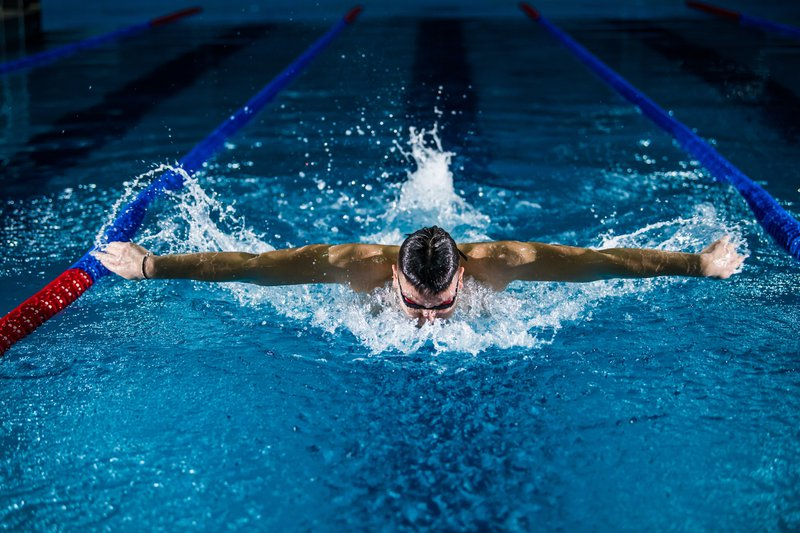Swimming is an excellent calorie-burning exercise - Man swimming