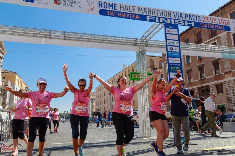 Women burning calories by running a half marathon