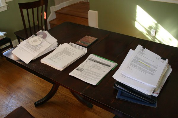 college acceptance rates image: a stack of college applications sits on a low wood table