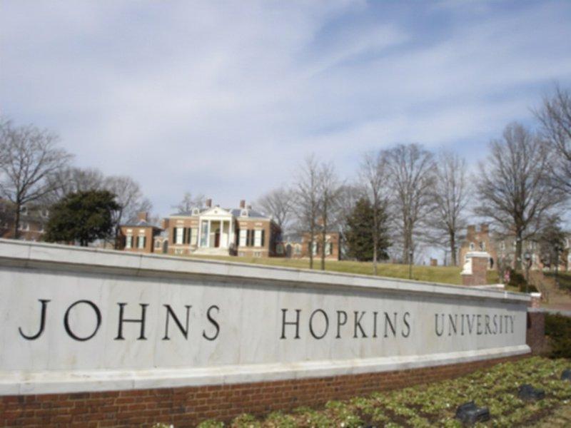 Johns Hopkins essay image: a photo of Johns Hopkins University's main campus and sign