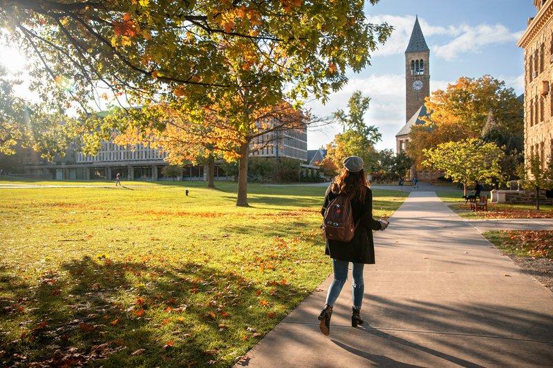 Student walking at Cornell