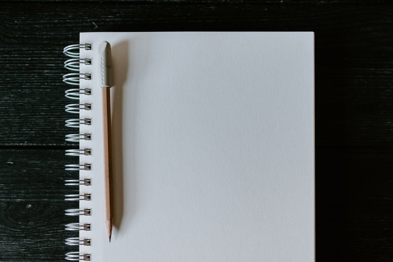 Wooden pencil on blank spiral notebook