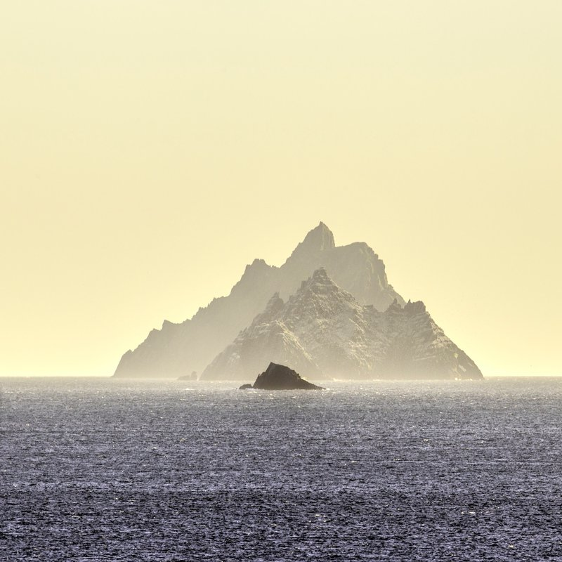 I photographed the Skelligs - rocky outcrops in the Atlantic off the coast of County Kerry  - from Saint David's Bay on the mainland. I chose my viewpoint to get the three rocks in the frame and used a 400mm lens to achieve the foreshortening effect. Skellig Michael - the largest - was the site of an ancient monastic settlement and is a UNESCO World Heritage Site. It is also now famous for featuring in the last two Star Wars movies.