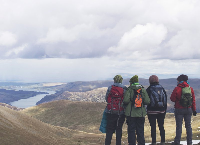 As I reached the top of Helvellyn from the Striding Edge approach, I took a photo of my friends posing by the summit. As I smiled and checked the photo, I noticed another group. Their arms locked together, they smiled at small jokes they made as they all stared at the lakes below us. I took this photo and then approached them to ask if they would like a copy. They were three sisters with their mother. The mother is the lady in green who's glasses you can just make out. The way they face the view as she clings fondly to her daughters; this image will always remind me of family.
