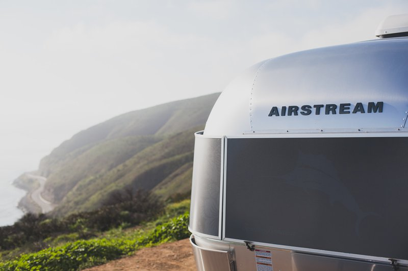 Airstream Travel Trailer on a Mountainside with Ocean View
