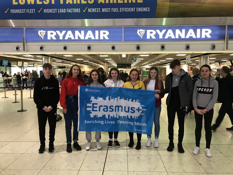 Students at Dublin Airport with their Erasmus+ flag