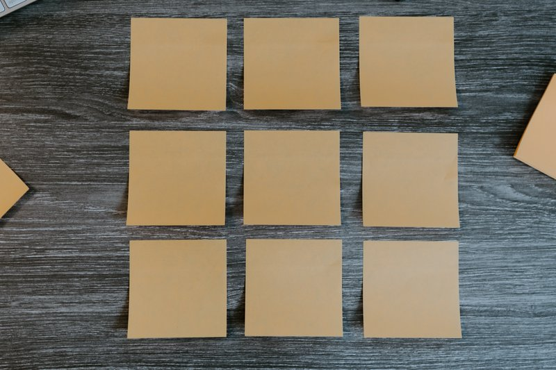 Group of blank sticky notes on a desk