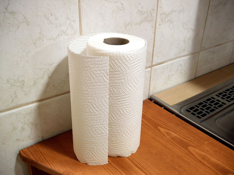 a roll of paper towel on a kitchen counter