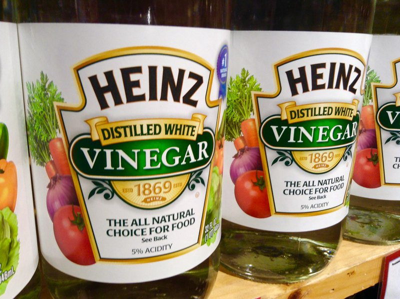 bottles of heinz distilled white vinegar - natural stain removers