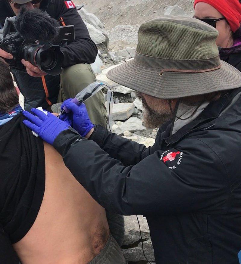 Dan Allaston tattooing on Everest