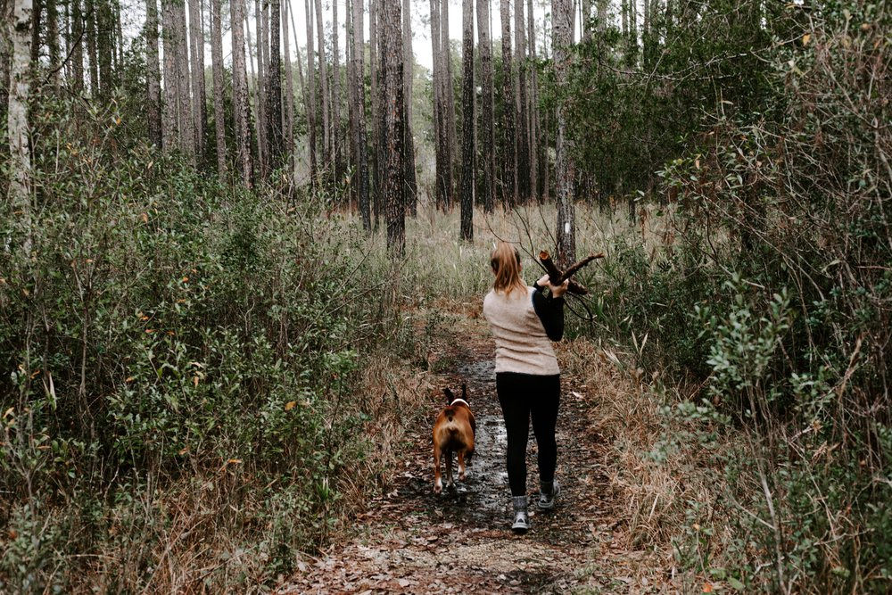 Woman hiking with dog - at risk for tick-borne disease
