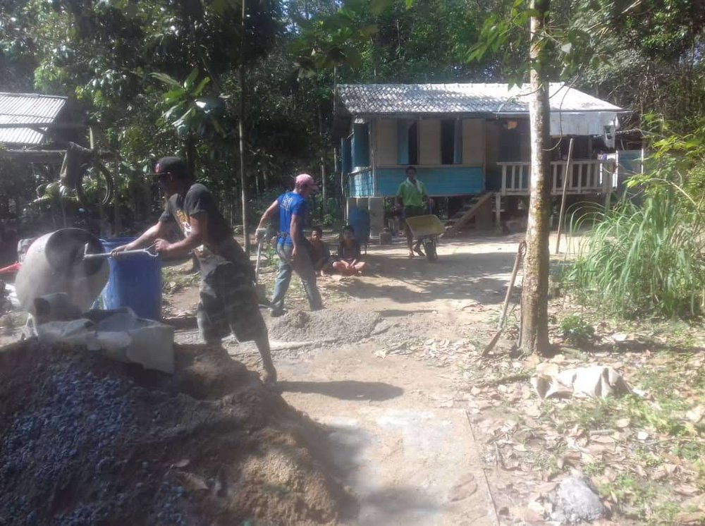 Orang asli community building cement mixer