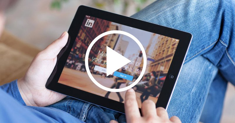 Person looking at iPad with Linkedin video