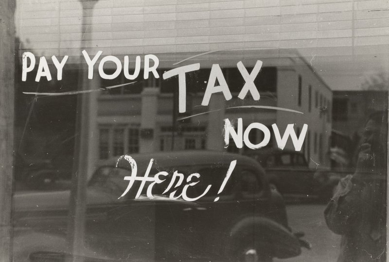 Sign, Harlingen, Texas.1939. Photographer Lee Russell; deferred payroll taxes