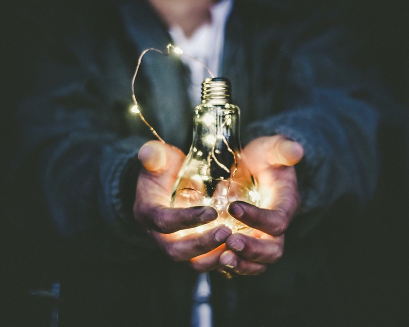 man with lightbulb in his hands, energy-saving tax credit