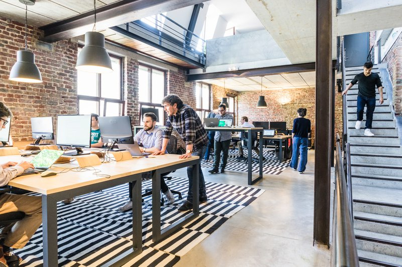 office with employees at computers, pension startup credit