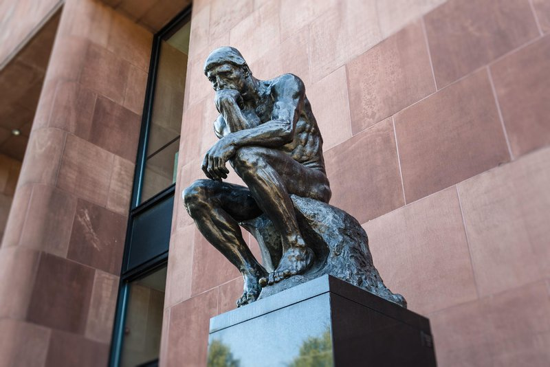 Statue of a man thinking; European style black statue; To show confusion regarding career choices