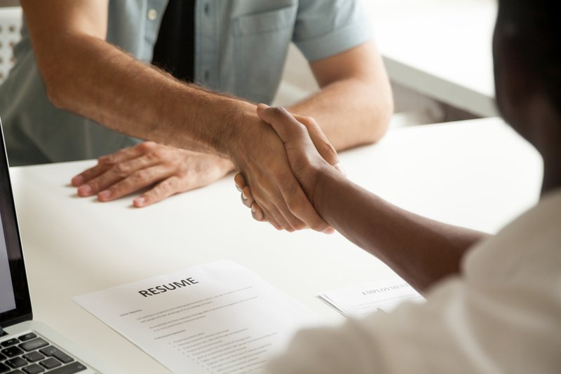 Employment handshake or making good first impression at successful interview concept