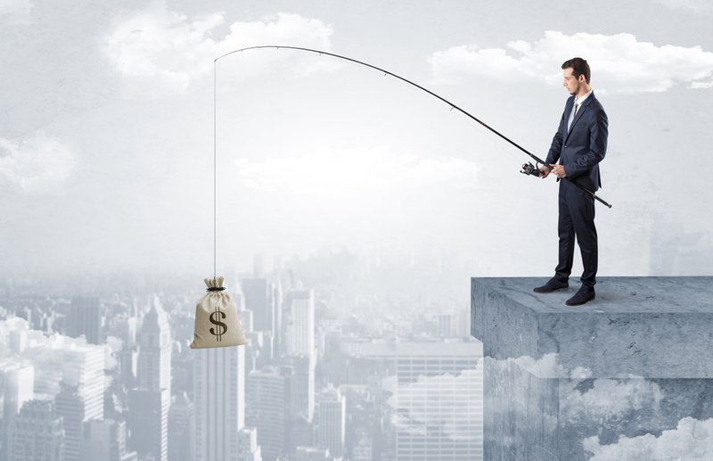 Man in a suit on the top of a sky scraper, fishing a bag of money with a rod. It depicts the first skill of personal finance - earning money