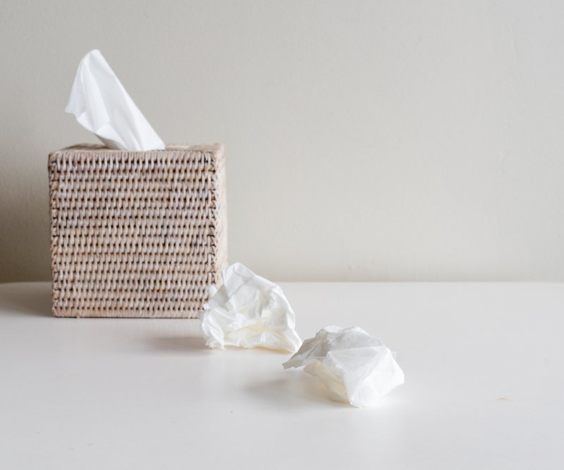 Image of a box of tissues on a table. The image indicates tissues needed to wipe tears.l