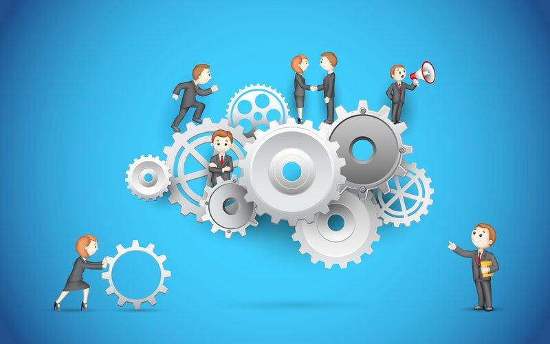 illustration of business people on cog wheel showing team work