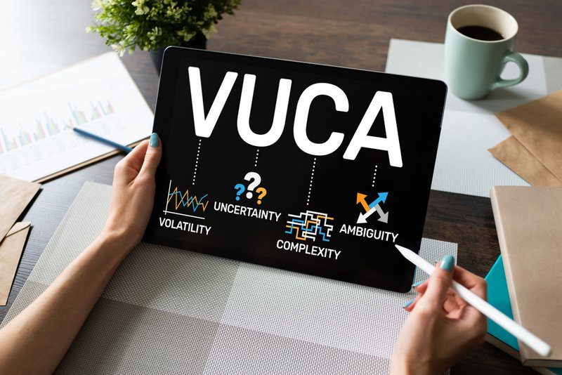 VUCA world concept on screen. Volatility, uncertainty, complexity, ambiguity. This is impacting our mental health.