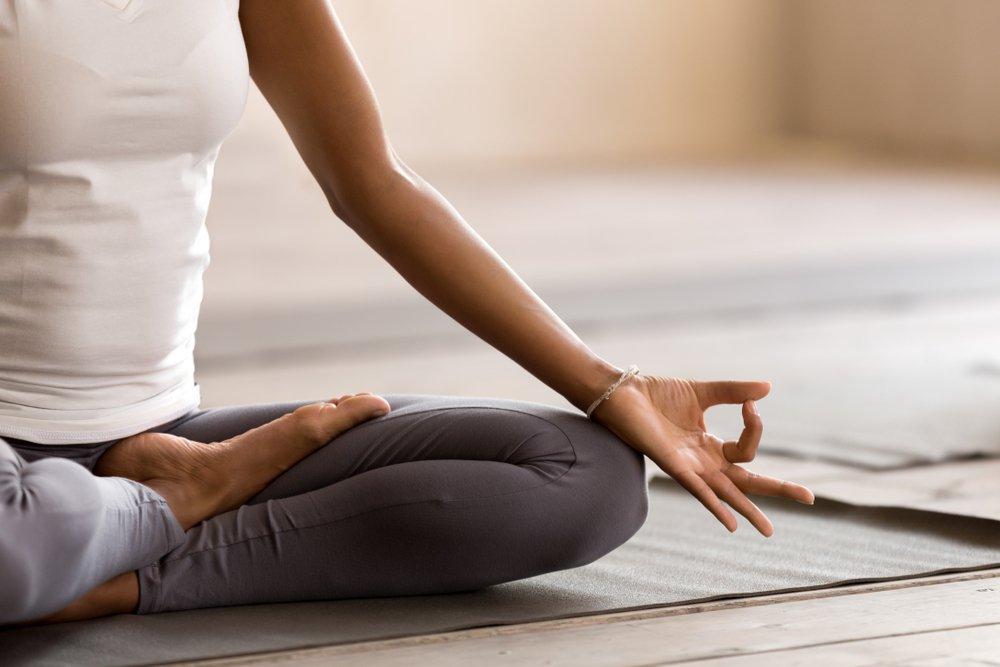 Woman practicing yoga lesson, breathing, meditating