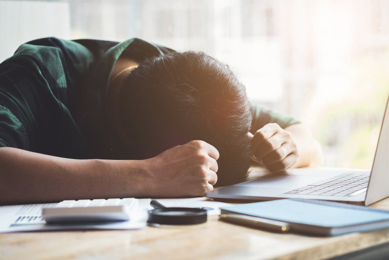 Burnout Syndrome, Man sleeping at his desk working over a laptop,Tried overworked