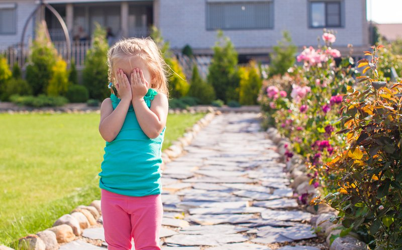 Little girl covering her face, does not want be photographed. Consent should be seeked from everyone.