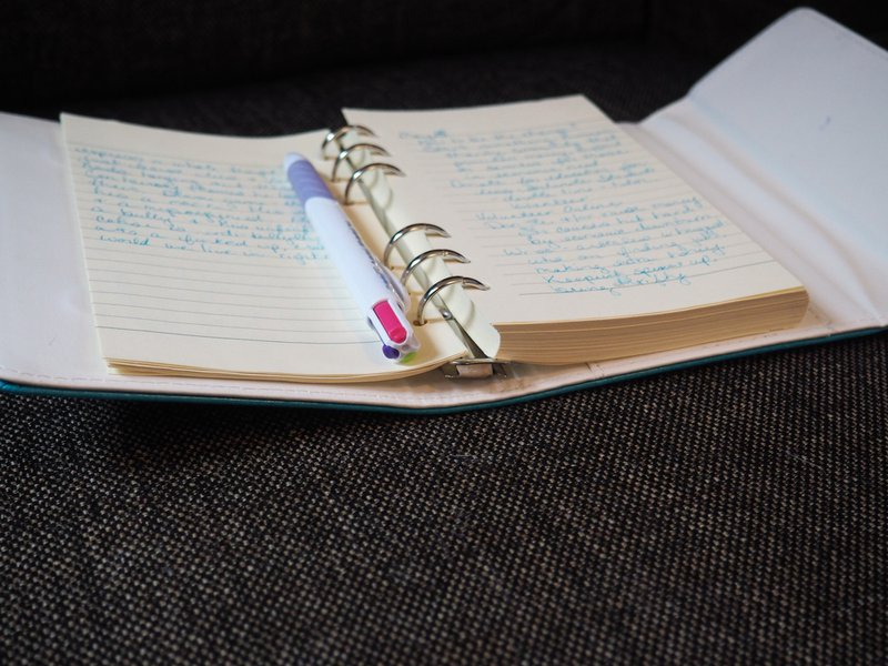 Open Journal with Handwritten Pages and Pen